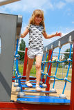 Young girl on playground Stock Images