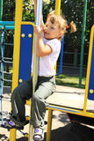 Young girl on the playground Stock Images