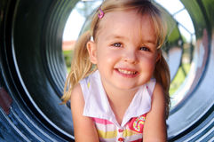 Young girl at playground Stock Photo