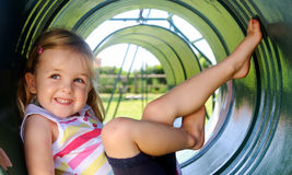 Young girl at playground Stock Photos