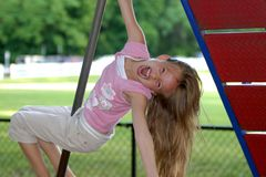 Young girl playing. This is a picture of a young girl playing at the playground of a public park Royalty Free Stock Image
