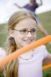 A young girl playing Royalty Free Stock Images
