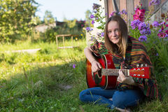 Young girl playing acoustic guitar, Stock Photos
