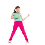Young girl playing the air guitar Royalty Free Stock Photo