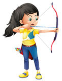A young girl playing archery Stock Photos