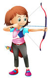 A young girl playing archery Stock Images