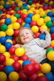 Young girl playing in a ball pool Stock Photos