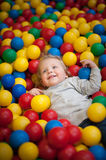Young girl playing in a ball pool Royalty Free Stock Photography