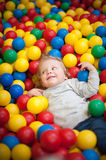 Young girl playing in a ball pool Stock Image