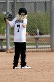 Young girl playing baseball Royalty Free Stock Photos