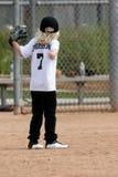 Young girl playing baseball royalty free stock photos