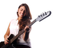 Young girl playing on a bass guitar Stock Photography