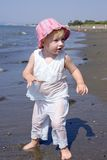 Young girl playing on beach royalty free stock images