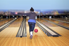 Young girl playing bowling Stock Images