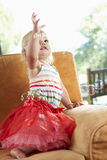 Young Girl Playing With Bubbles On Sofa Royalty Free Stock Image