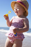 Young Girl Playing With Bubbles On Sunny Beach Royalty Free Stock Photos