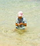 A young girl playing in the caribbean sea Stock Image