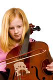 Young girl playing cello. Isolated on a white background royalty free stock image