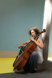 Young girl playing cello Royalty Free Stock Photos