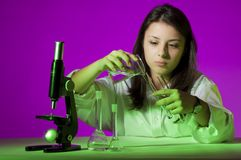 Young girl playing chemist Stock Photography