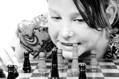 Young girl playing chess stock photography