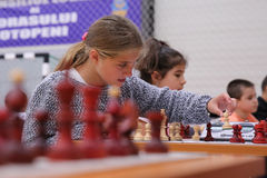 Young girl playing chess Stock Image
