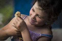 Young girl playing with chick Royalty Free Stock Image