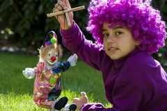 Young girl is playing with a clown Royalty Free Stock Photo