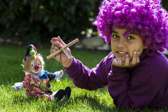 Young girl is playing with a clown Royalty Free Stock Images