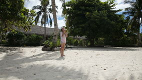 Young girl playing with coconut stock footage
