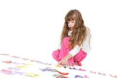 Young girl playing with colorful letters Stock Photography