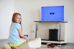 Young girl playing in front of the TV Royalty Free Stock Photography