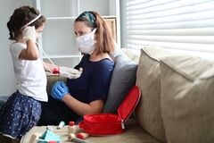 Free Young Girl Playing Doctor With Mother Diagnosed As Infected In Coronavirus COVID-19 In A Self Home Isolation Lock Down Stock Photos - 177676343