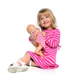 Young Girl Playing with Doll Royalty Free Stock Photo
