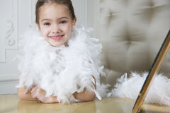 Young girl playing at dressing up Stock Photo