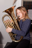 Young girl playing euphonium Stock Images