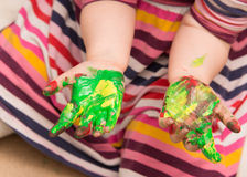 Young girl playing with finger paint Royalty Free Stock Photos