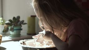 Girl playing with flour while preparing dough stock footage