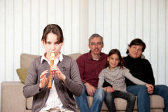 Young girl playing flute Royalty Free Stock Photo
