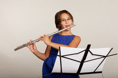 Young Girl Playing a Flute Stock Photo