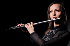 A young girl playing the flute Royalty Free Stock Image