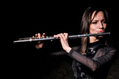 A young girl playing the flute Royalty Free Stock Images