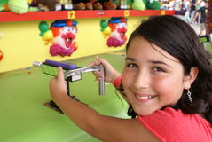 Young Girl Playing a Game at Fair or Carnival Royalty Free Stock Photos