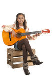 Young girl playing the guitar Royalty Free Stock Image