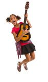 Young girl playing a guitar Stock Images