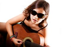 Young girl playing guitar, landscape Royalty Free Stock Photo