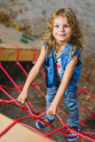 Young girl playing when having fun doing activities outdoors. Royalty Free Stock Photos