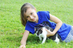Young girl playing with her cat Royalty Free Stock Photo