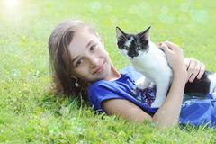 Young girl playing with her cat Royalty Free Stock Photography