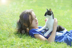 Young girl playing with her cat Royalty Free Stock Images